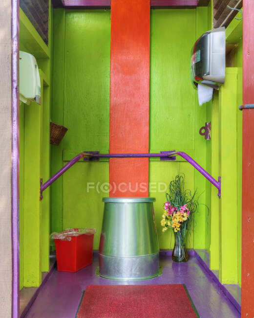 Camping toilet in multicolor bathroom — Stock Photo