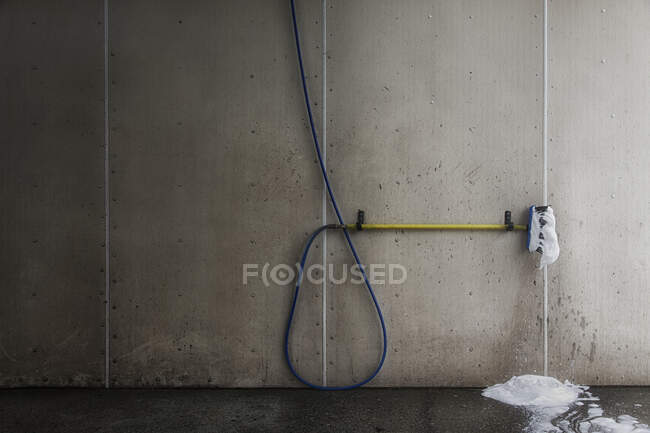 Foaming brush with hose in car wash — Stock Photo