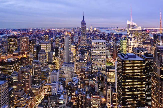 Aerial view of highrise buildings in cityscape at twilight — Stock Photo