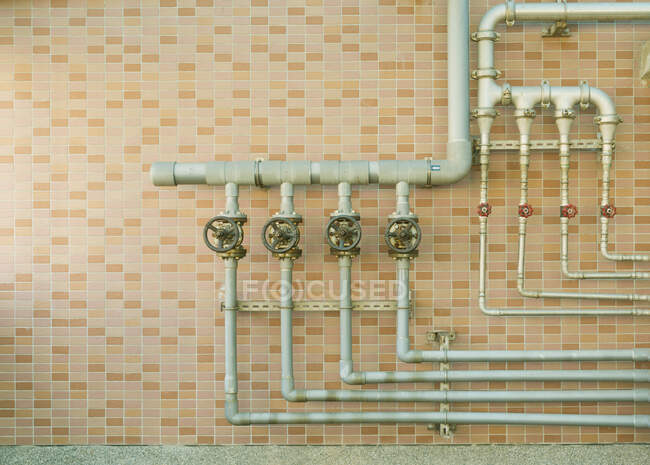 Water pipes on brick wall — Stock Photo