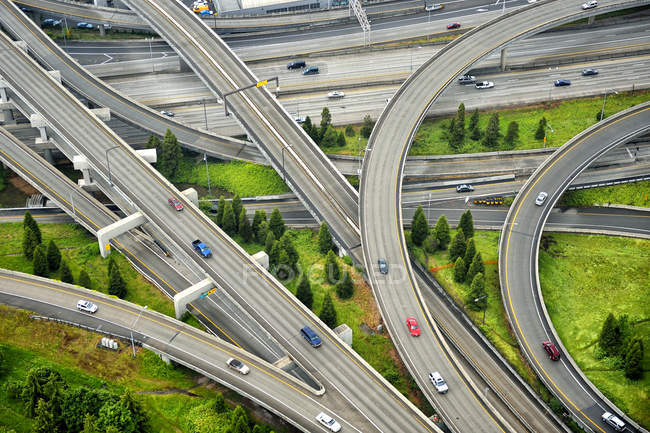 Aerial view of interstate change overpasses with cars — стокове фото