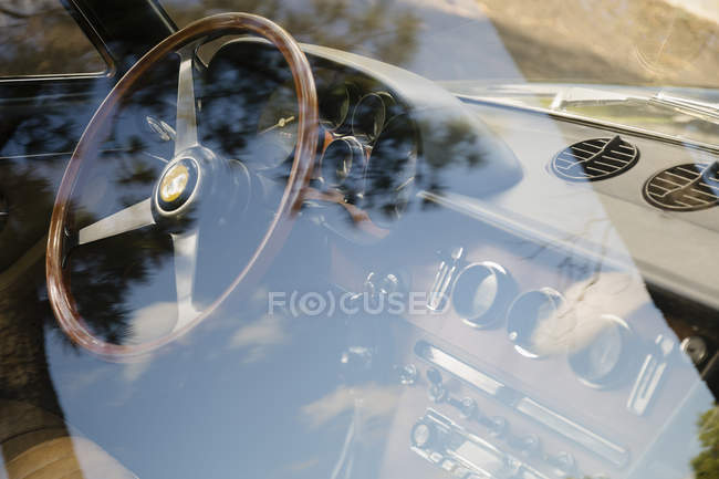 Vintage Ferrari dashboard and steering wheel through vehicle window — Stock Photo
