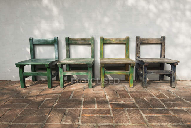 Empty wooden chairs outdoors — Stock Photo
