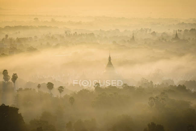 Aerial view of ancient towers in misty landscape of Myanmar — Stock Photo