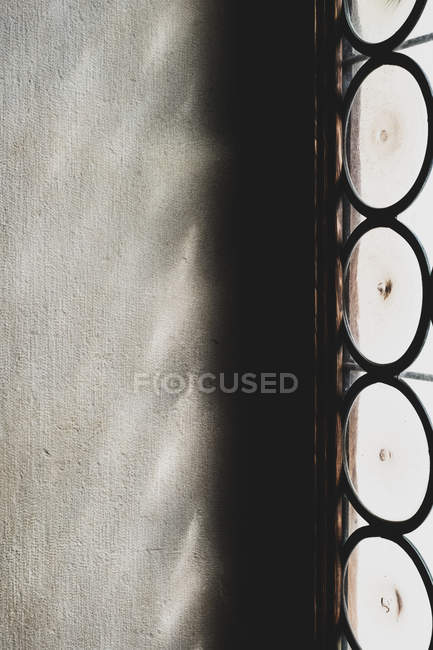 Close-up of sunlight reflecting onto wall through leaded glass window. — Stock Photo