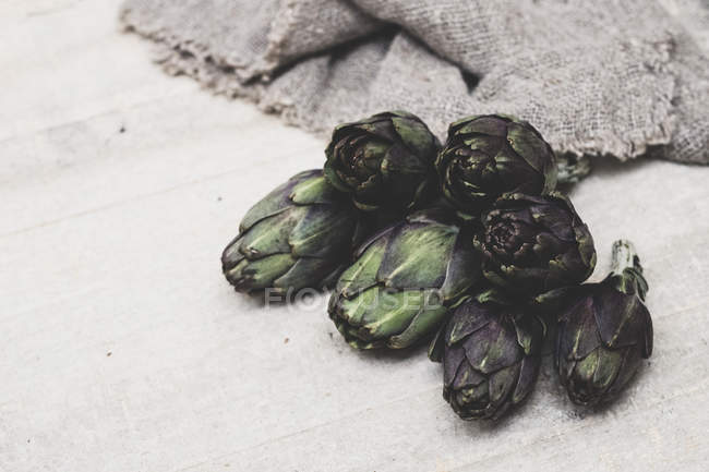 High angle view of fresh artichokes on grey background. — Stock Photo