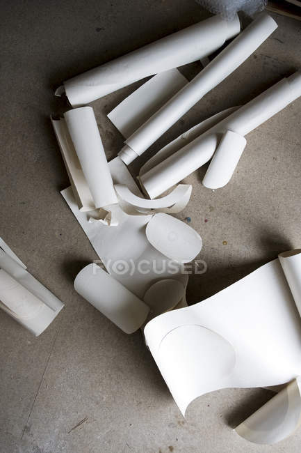 High angle close-up of rolls and cut-offs of stiff rolled drawing paper. — Stock Photo