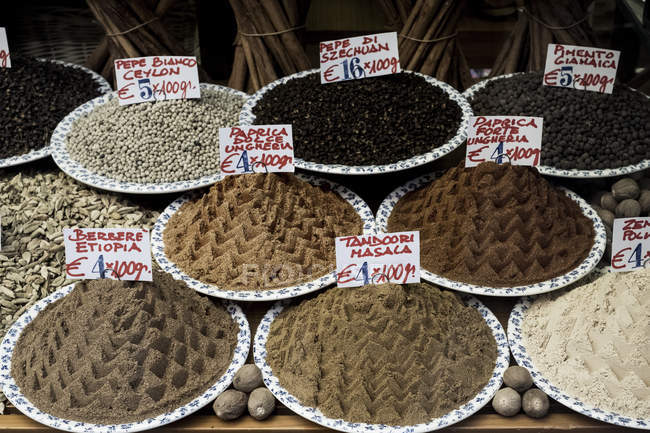 High angle view of selection of peppers and spices at Italian market stall. — Stock Photo