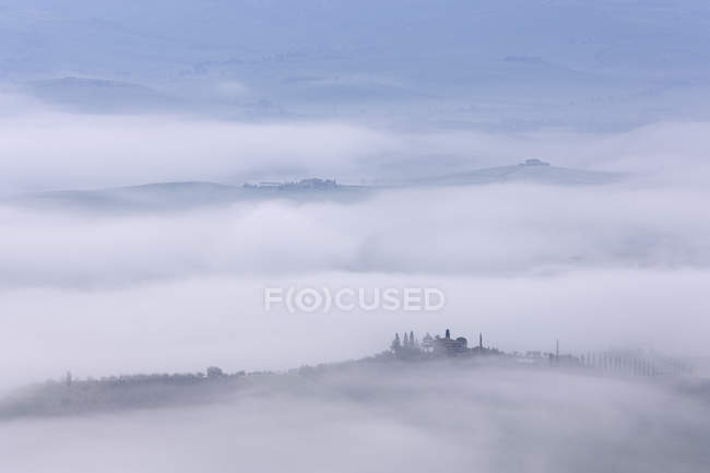 Valley fog in Val Dorcia at dawn, Italy, Europe — Stockfoto