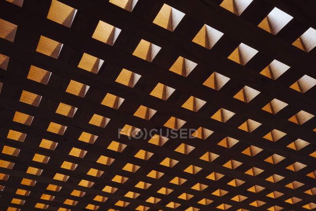 Backlit cutout squares indoors, full frame — Stock Photo