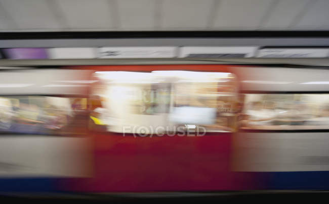 Subway train in motion blur in London, England, UK — Foto stock