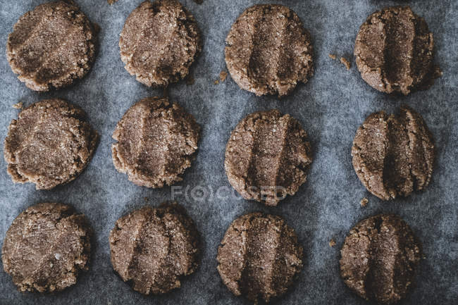 High angle close-up of chocolate cookie dough on baking tray. — Stock Photo