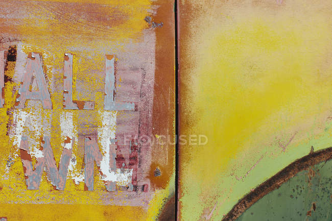 Peeling lettering and paint on side of old abandoned truck — Stock Photo