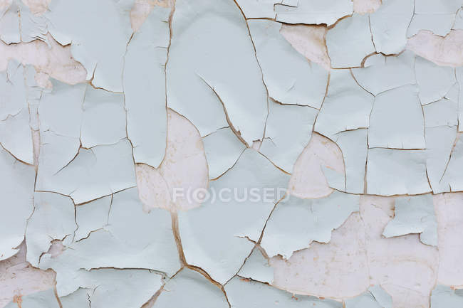 Close-up of peeling paint with cracks on weathered wall. — Stock Photo