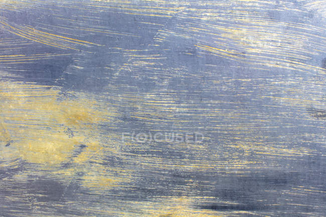Close-up of grey metallic paint with scratches on metal. — Stock Photo