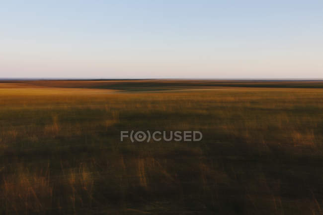 Abstract view of Tallgrass Prairie Preserve landscape at dusk in Great Plains, Kansas, USA. — Stock Photo
