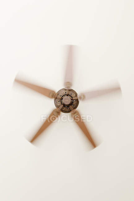 Indoor ceiling fan with motion blur in rotation — Stock Photo