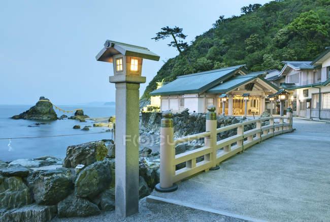 Buildings, pier and Wedding rocks at Futamigaura Shrine, Ise, Japan — стоковое фото