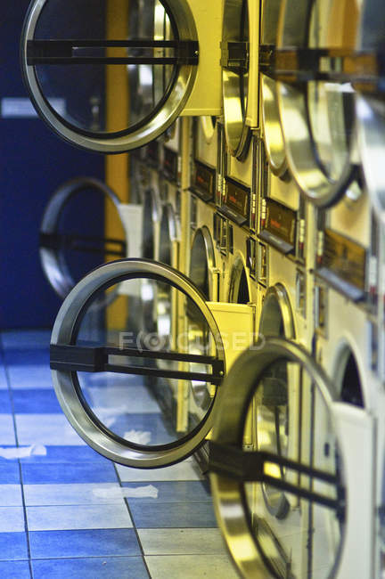 Washers and dryers with open doors in public laundromat — Stock Photo