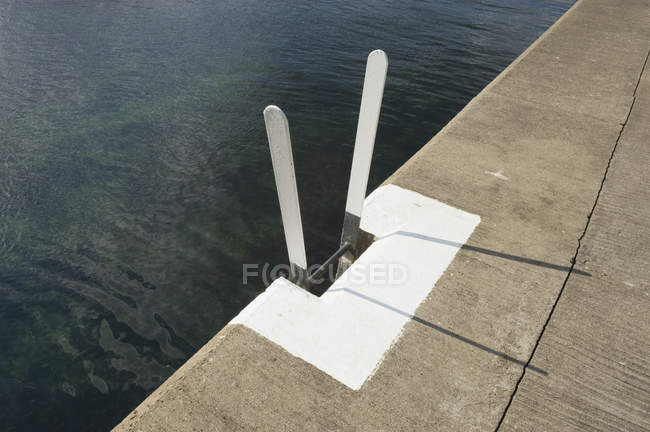 Ladder on harbor pier, high angle view — Stock Photo