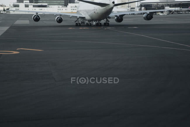 Detail of plane on airport tarmac in Shanghai, China, Asia — Stock Photo