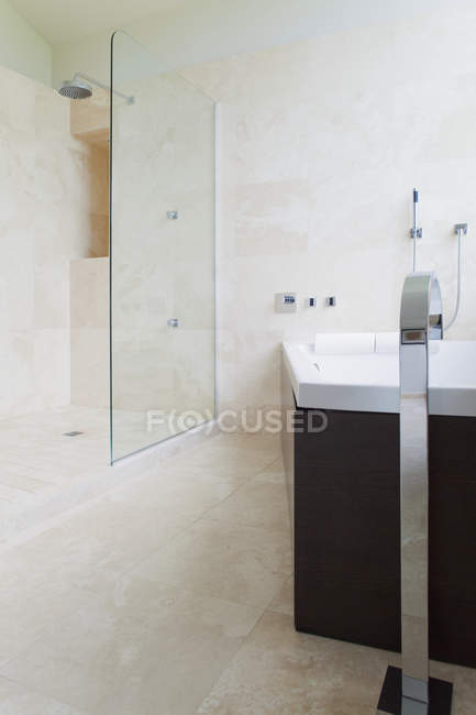Modern bathroom interior with glass door and granite tiles — Stock Photo