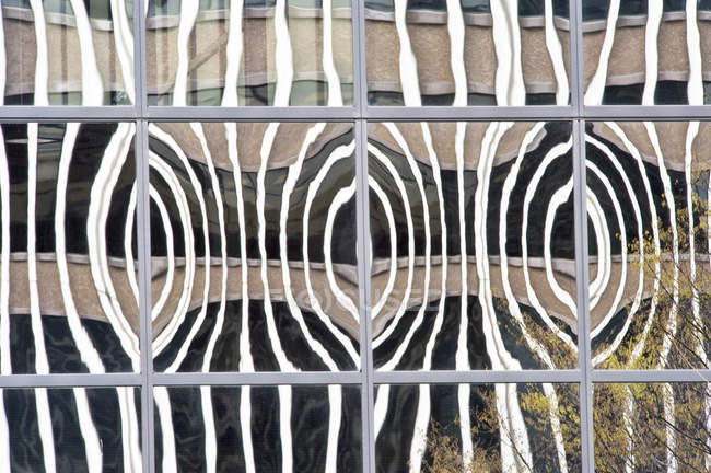 Distorted window reflection on building in full frame — Stock Photo