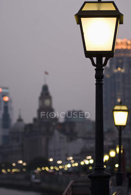 Street lights illuminating in Bund, Shanghai, China — Stock Photo