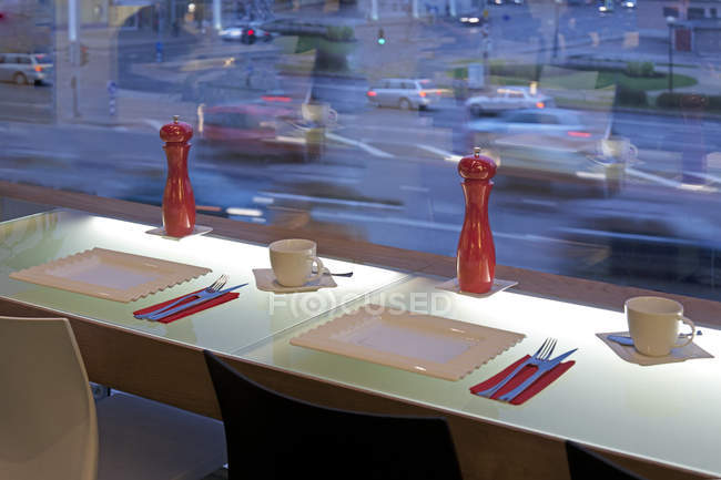 Window seating and table in upscale cafe in Tartu, Estonia — Stock Photo