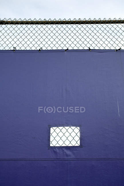 Tarp covering chain link fence, full frame — Stock Photo