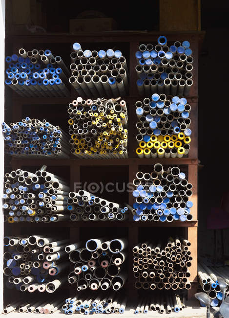 Supplies of metal poles on industrial shelves, Jaipur, Rajasthan, India — Stock Photo