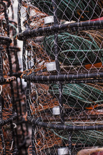 Crab and lobster pots stacked on quayside, close-up. — Stock Photo