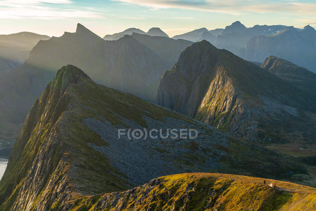 Aerial view of people and tent perched on ridge in dramatic peaks of Senja Island, Troms, Norway, Europe. — Stock Photo