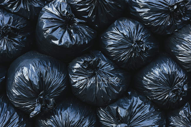 Pile of black plastic garbage bags. — Stock Photo