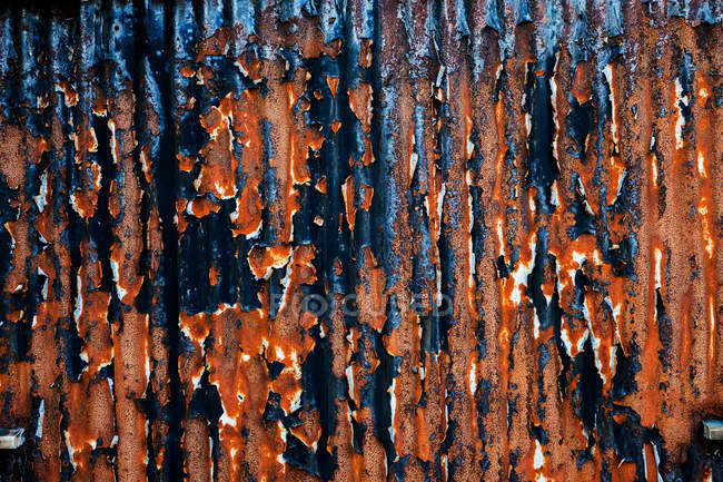 Close-up of old rusty corrugated iron wall. — Stock Photo