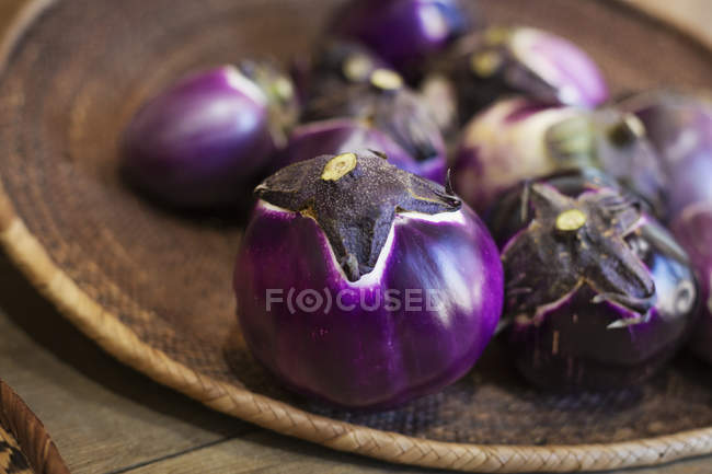 High angle close-up of a selection of fresh purple aubergines in a farm shop. — Stock Photo