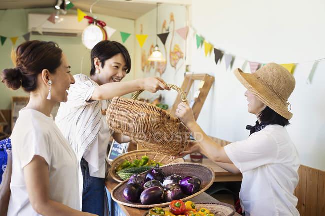 Japanese women shopping fresh vegetables in a farm shop. — Stock Photo
