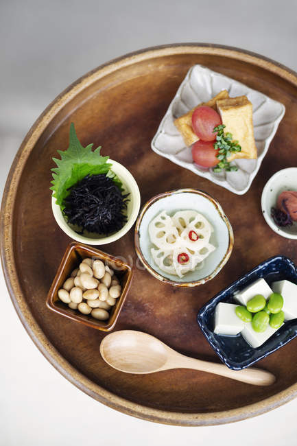High angle close-up of a selection of vegetarian Japanese food plates in a cafe. — Stock Photo