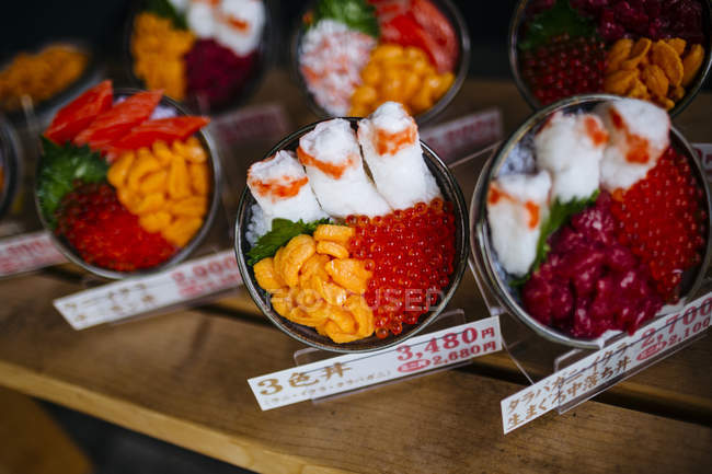 High angle close-up of plastic bowls of Japanese food on display outside of a restaurant. — стокове фото