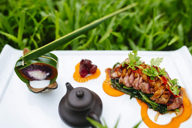 High angle close-up of seared duck breast with coconut sticky rice. — стокове фото