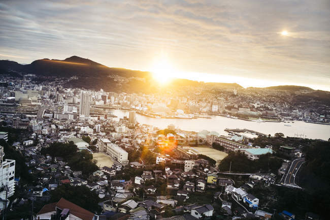 Aerial view of cityscape of Nagasaki city at sunrise in Japan — Stock Photo