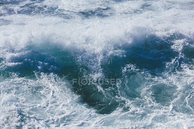 Churning ocean water and waves, high angle view — стокове фото