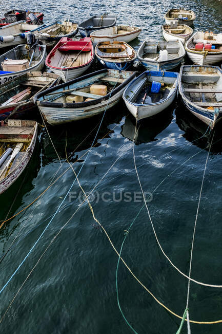 High angle view of colorful wooden fishing boats moored side by side in an harbor — Stock Photo