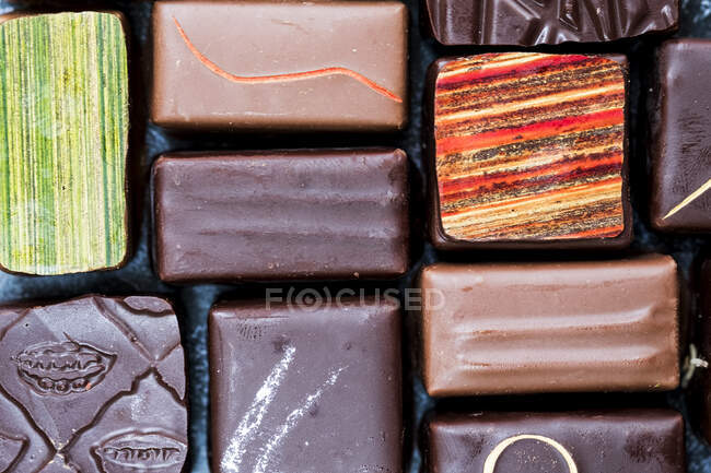 High angle close up of a selection of chocolate pralines. — Stock Photo