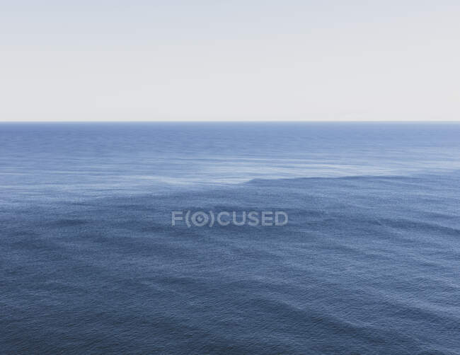 View of expansive ocean, horizon and sky at dusk, northern Oregon coast — Stock Photo