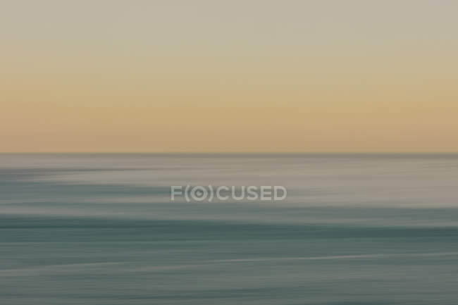 View of ocean, horizon and sky at dawn, blurred motion, northern Oregon coast — Stock Photo