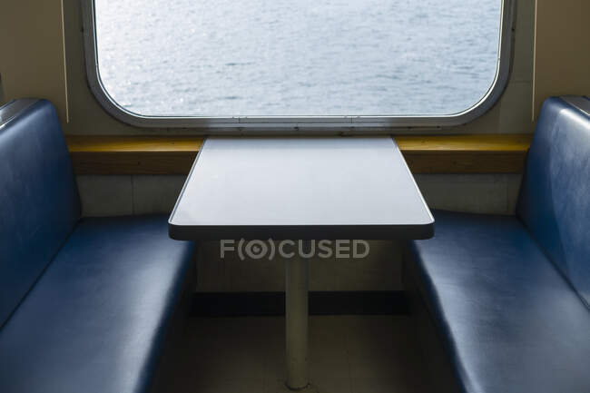 Interior of passenger ferry boat and view over the waters of Puget Sound. — Stock Photo