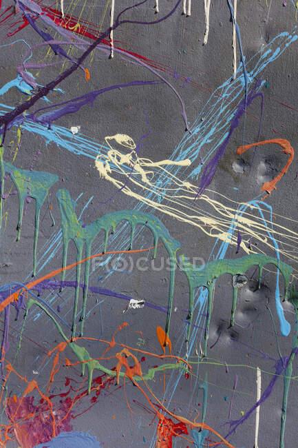 Colorful graffiti paint splatters on urban wall, close up — Stock Photo