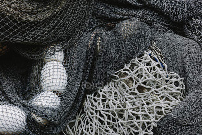 Pile of commercial fishing nets and gillnets on a fishing quay, close-up — Stock Photo