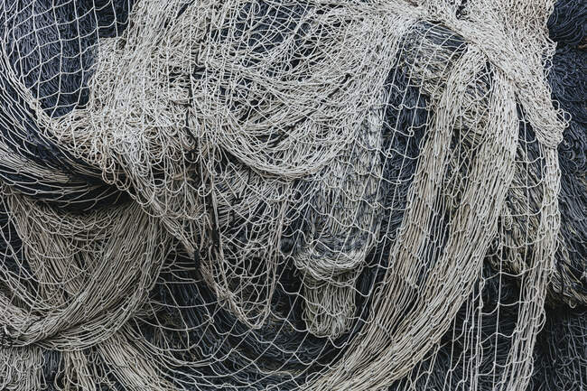Pile of commercial fishing nets and gillnets on a fishing quay — Stock Photo